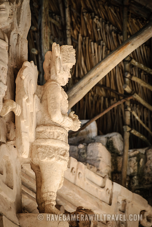 """Carved statue of a winged warrior on the exterior of the Tomb of Ukit Kan Le'k Tok' on top of the Acropolis on the northern side of the Ek'Balam archeological site on Mexico's Yucatan Peninsula. It was once a thriving city of Maya Civilization dating to the Late Classic period. It is 30km north of Valladolid and is named for """"Black Jaguar"""" a distinctive motif throughout the site."""