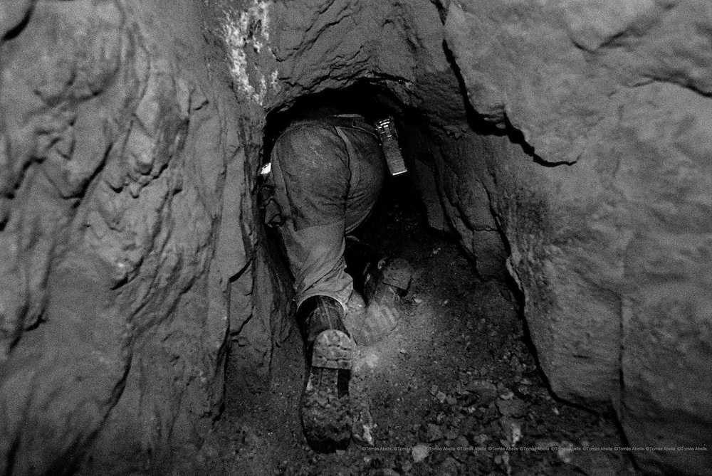 To get to the seam they have to haul themselves through a tunnel barely 60 centimeters in diameter.  Siglo XX tin mine. Llallagua, Bolivia.