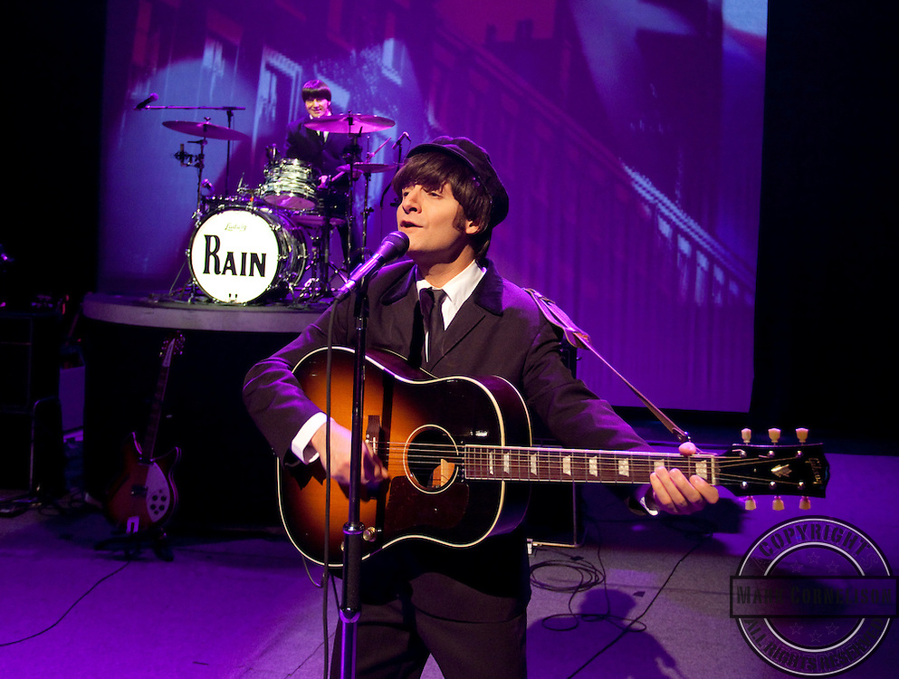 RAIN A tribute to the Beatles, photographed at the Lexington Opera House  on Sunday March 6, 2011 in Lexington ,Ky . Photo by Mark Cornelison