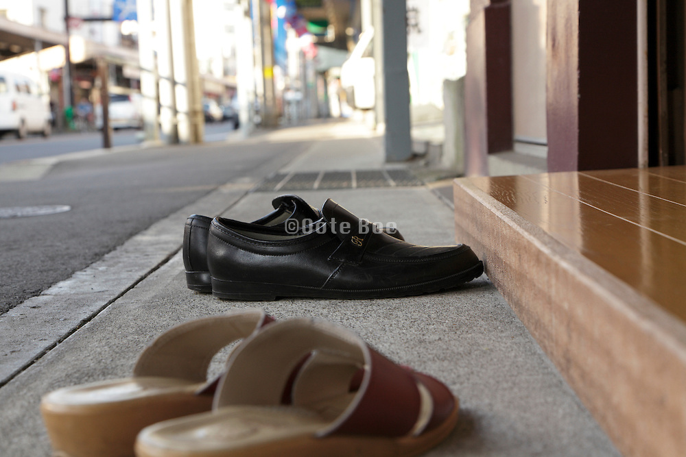 slippers and shoes in front of entrance door Japan