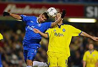 Photo: Scott Heavey.<br /> Chelsea v Birmingham City. FA Barclaycard Premiership. 18/01/2004.<br /> Adrian Mutu and Stephen Clemence battle for the ball
