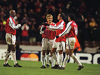 Fotball: Junichi Inamoto, Arsenal celebrates with his team mates,Edu,Henry and Vieira at the final whistle. Arsenal v Bayer Leverkusen. Champions League. 27.02.2002.<br /><br /> Foto : Andrew Cowie/Digitalsport.