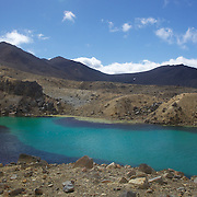 The Emerald Lake on the Tangariro Alpine Crossing.  The Tongariro Alpine Crossing is a 7-8 hour hike traversing two active volcanoes within the Tongariro National Park, North Island, New Zealand.  It is considered to be the best one day hike in New Zealand and in the top 10 one day hikes in the world. Packed into the 19.4km hike is an array of diverse landscapes and vegetations. From tussock like alpine meadows, to rugged lava flows, desert like craters and emerald lakes.  The Tongariro Alpine  9th January 2011. Photo Tim Clayton..