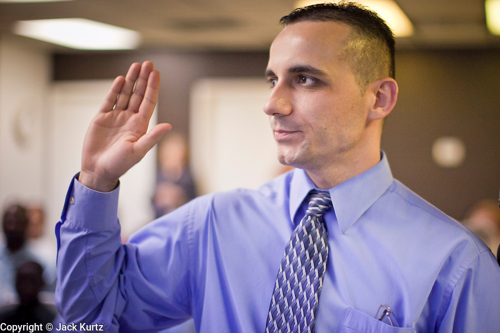 June 21, 2010 - PHOENIX, AZ: ZORAN KORDIC, originally from Croatia, takes the citizenship oath during a naturalization ceremony for former refugees at the International Rescue Committee offices in Phoenix, AZ, Monday, June 21. World Refugee Day was Sunday, June 20; the IRC and US Citizenship and Immigration Services offices  marked the day by holding a naturalization ceremony for 10 people who came to the US as refugees.  Photo by Jack Kurtz