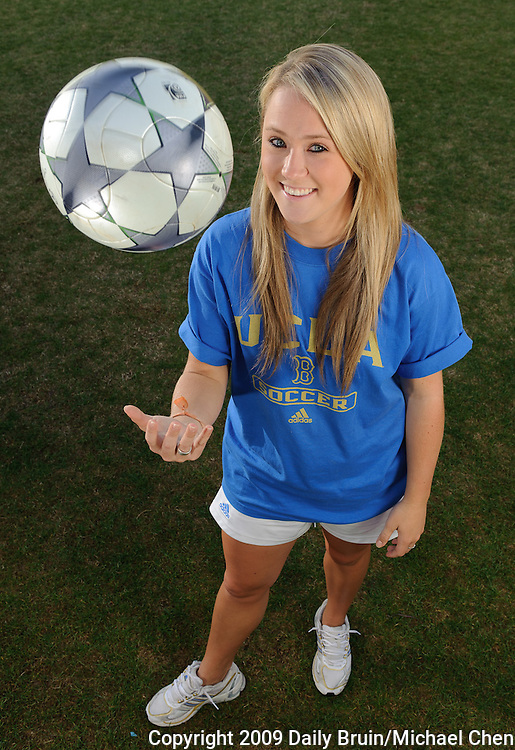 Third-year communication studies student Kerry Bradley manages the UCLA womens soccer team. She remains close with her father and brother even though they are often on the road with the U.S. men's national team.