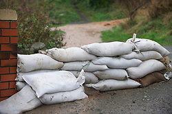 © Licensed to London News Pictures. 26/11/2012..Skinningrove, England..Sandbags are ready to try and prevent flooding at Skinningrove in North Yorkshire after another day of heavy rain causes disruption in parts of East Cleveland and North Yorkshire...Photo credit : Ian Forsyth/LNP