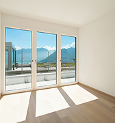 Interior, empty room of a modern apartment with windows