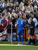 Photo: Richard Lane.<br /> Aston Villa v Birmingham City. Barclaycard Premiership. 22/02/2004.<br /> Robbie Savage appears to hand a thrown object to the assistant referee.