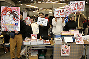 """""""SCHOOL SWEETS XR"""" adult manga stall. TOKYO COMIC MARKET """"COMIKET"""" the biggest comic market in Japan. Independent designers come to sell their comics, there is anime, manga, cosplay, toys, posters etc. At """"Tokyo Big Sight"""" exhibition center."""