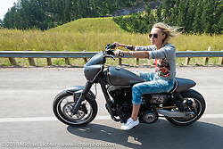 Leticia Cline on the Legends Ride after leaving Deadwood, SD during the Sturgis Black Hills Motorcycle Rally. SD, USA. August 4, 2014.  Photography ©2014 Michael Lichter.