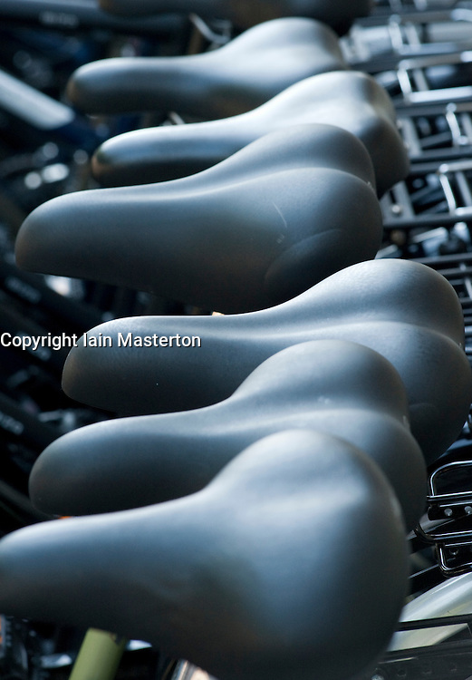 Close up of saddles on new bicycles for sale outside shop in Berlin Germany