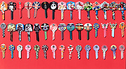 Display rows of picture Yale keys on red background, UK
