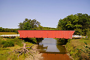 """14 SEPTEMBER 2020 - WINTERSET, IOWA: The Hogback Bridge in Madison County was built in 1884. The covered bridges of Madison County are an enduring tourist attraction more than 25 years after the book and movie """"The Bridges of Madison County"""" made them famous. There are six covered bridges in Madison County, all built in the 1800s. They are remnants of about 100 covered bridges built in Iowa from the 1850s through the late 1800s. Most of the briges were washed away in floods, condemned, or destroyed in fires. The Madison County bridges have been restored and rebuilt through the years.    PHOTO BY JACK KURTZ"""
