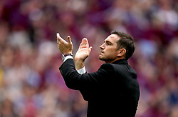 Derby County manager Frank Lampard applauds the fans at the end of the Sky Bet Championship Play-off final at Wembley Stadium, London.