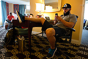 Johny Hendricks plays games on his phone before heading to the American Airlines Center for his title fight against Robbie Lawler at UFC 171 in Dallas, Texas on March 15, 2014.