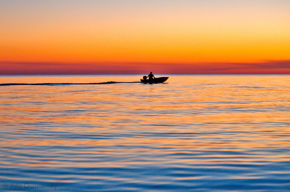Man in boat after fishing on Lake Pontchartrain