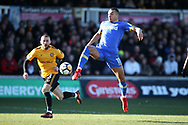 Jay -Roy Grot of Leeds Utd gets to the ball ahead of Dan Butler of Newport county. Emirates FA Cup , 3rd round match, Newport county v Leeds Utd at Rodney Parade in Newport, South Wales on Sunday 7th January 2018.<br /> pic by Andrew Orchard,  Andrew Orchard sports photography.