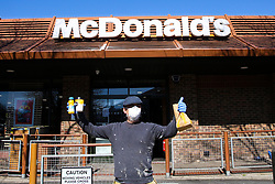 © Licensed to London News Pictures. 23/03/2020. London, UK. A man wearing a face mask leaves McDonald's, Haringey north London holding a meal and drinks. McDonald's restaurants across the UK are to close from 7pm tonight as the spread of the coronavirus continues in the country. Photo credit: Dinendra Haria/LNP