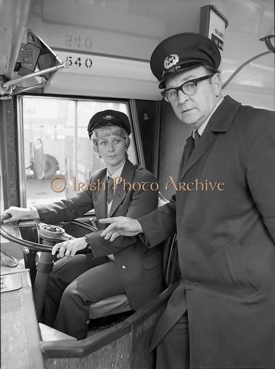 At the Wheel:..At the Wheel:..1980-05-02.2nd May 2012.02/05/1980.05-02-80..Photographed at Phibsborough Garage, Dublin...First Ever Woman CIE Dublin City Bus Driver, Joan Doran, 171 Ballyfermot Road, Dublin. Her first assignment is from Conyngham Road Garage on May 4. ..Inspector Bill McNally lends a helping hand. ..