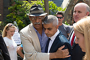 London Mayor, Sadiq Khan with local resident outside St Clement's Church following Sunday morning service on 18th June 2017 in North Kensington, London, United Kingdom. The Grenfell Tower fire occurred on 14th June 2017 at the 24-storey block of public housing flats in North Kensington, West London. It caused at least 80 deaths and over 70 injuries, yet the actual numbers have yet to be confirmed