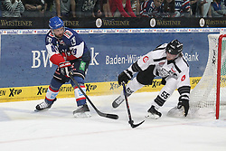 03.10.2014, SAP Arena, Mannheim, GER, DEL, Adler Mannheim vs Thomas Sabo Ice Tigers, 7. Runde, im Bild Jamie Tardif (Adler Mannheim) im Zweikampf mit David Prinz (Thomas Sabo Ice Tigers), Aktion / Action // during germans DEL Icehockey League 7th round match between Adler Mannheim and Thomas Sabo Ice Tigers at the SAP Arena in Mannheim, Germany on 2014/10/03. EXPA Pictures © 2014, PhotoCredit: EXPA/ Eibner-Pressefoto/ Neis<br /> <br /> *****ATTENTION - OUT of GER*****