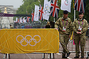 Soldiers the Royal Artillery regiment in the British army stand guarding the entrance to  the volleyball venue in central London next to the IOC rings logo on day 4 of the London 2012 Olympic Games. A total of 18,000 defence personel were called upon to make the Games secure following the failure by security contractor G4S to provide enough private guards. The extra personnel have been drafted in amid continuing fears that the private security contractor's handling of the £284m contract remains a risk to the Games.