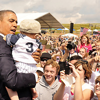 President Barack Obama holds a toddler while greeting the guests and visitors to the Flight 93 National Memorial on September 11, 2001, near the small town of Shanksville Pennsylvania.. UPI/Archie Carpenter