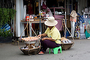 Southeast Asia, Thailand, Bangkok. The Sunday market. Selling fresh eggs from a basket,