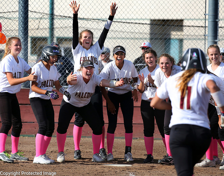 The Scotts Valley High softball team celebrates at home plate as Lauren LaHood rounds the bases after smashing a 2-run walk-off home run to right field in the seventh inning to defeat San Lorenzo Valley 5-3 on Wednesday May 10, 2017 in Scotts Valley, California.<br /> Photo by Shmuel Thaler <br /> shmuel_thaler@yahoo.com www.shmuelthaler.com