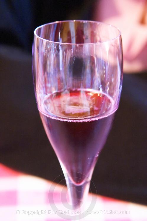 a glass of Brut nature Negro red sparkling wine. Bodega Pisano Winery, Progreso, Uruguay, South America