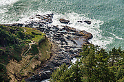 Stairs descend to the Devils Churn, a turbulent narrow inlet of the Pacific Ocean at Cape Perpetua Scenic Area, in Siuslaw National Forest, near Yachats, Oregon coast, USA.