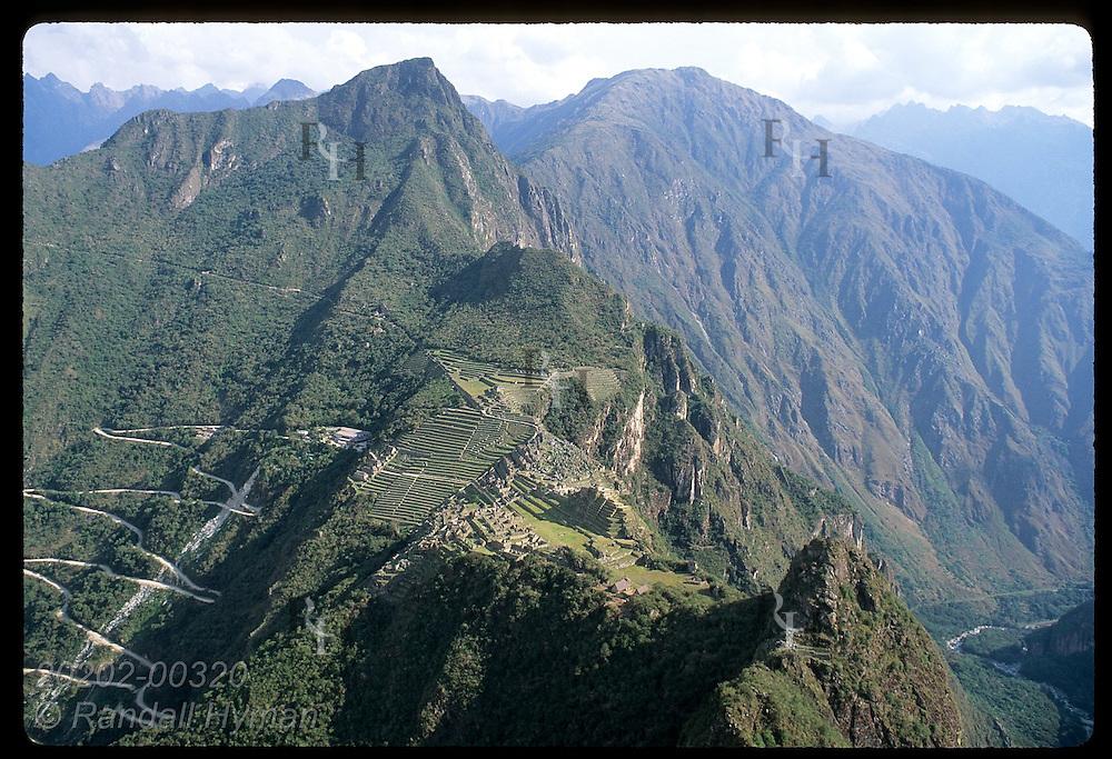 View from atop peak Huayna Picchu of Hiram Bingham Road & entire ancient city of Machu Picchu. Peru
