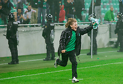 Happy young player of Olimpija with jersey after the game when Green Dragons, supporters of Olimpija celebrate their 25th Anniversary during football match between NK Olimpija Ljubljana and NK Celje in 14th Round of Prva Liga Telekom Slovenije 2013/14, on October 19, 2013 in SRC Stozice, Ljubljana, Slovenia. (Photo by Vid Ponikvar / Sportida)