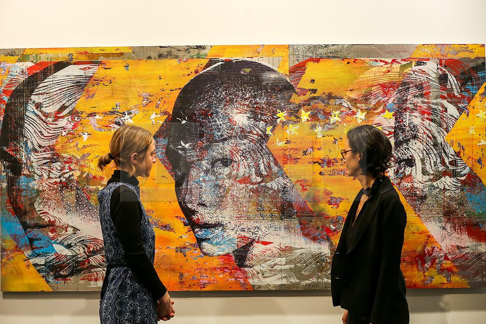 © Licensed to London News Pictures. 21/01/2020. London, UK. Women view Yoakim Belanger's artwork titled 'The Dreamers' during the preview of London Art Fair at Business Design Centre in north London. The fair opens on 22 January and runs until 26 January, which showcases modern and contemporary artwork from galleries around the world. Photo credit: Dinendra Haria/LNP