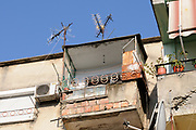 An insecure looking balcony on an old building. Tirana, Albania. 02Sep15