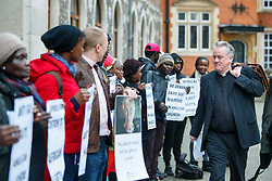 © Licensed to London News Pictures. 15/02/2017. London, UK. A bishop walks past whilst LGBT Campaigners, including Peter Tatchall, hold a protest vigil outside the General Synod of the Church of England, where same sex marriage is due to be debated. Photo credit: Tolga Akmen/LNP