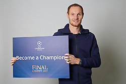 "CARDIFF, WALES - Monday, November 7, 2016: Wales' Shaun MacDonald holds up a board ""Become a Champion"" to encourage people to become volunteers for the 2017 UEFA Champions League Final in Cardiff. (Pic by David Rawcliffe/Propaganda)"