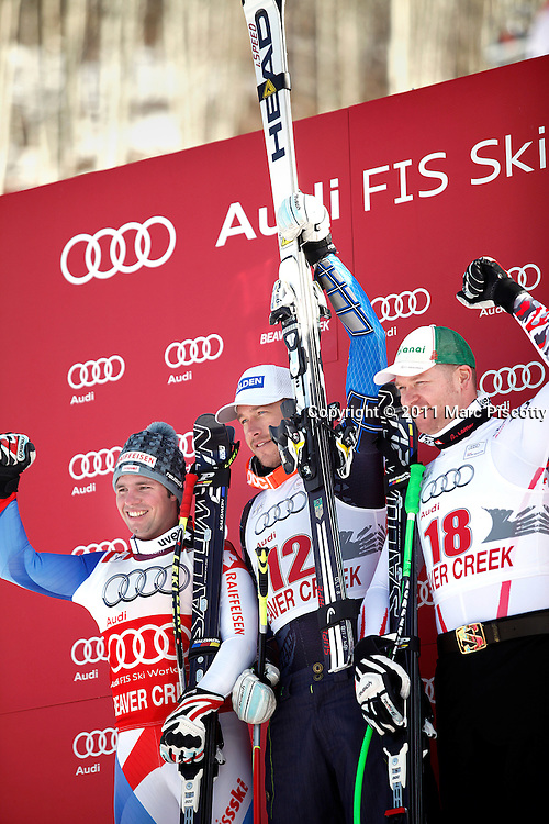 SHOT 12/2/11 2:18:15 PM - The top three finishers in the Birds of Prey downhill including (left to right) Beat Fuez (2nd), Bode Miller (1st) and Klaus Kroell (3rd) take to the podium after the Audi FIS World Cup on December 2, 2011 in Beaver Creek, Co. (Photo by Marc Piscotty / © 2011)