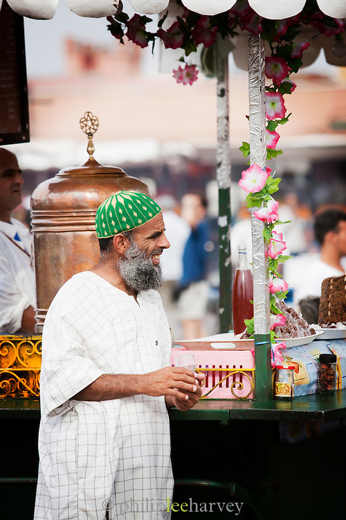 A man at a stall on the Djemaa el Fna in the medina of Marrakech in Morocco
