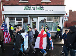 © Licensed to London News Pictures . 20/01/2018. Doncaster, UK. Far-right street protest movement , the English Defence League ( EDL ) march through Hexthorpe after holding a demonstration , opposed by anti-fascists , including Unite Against Fascism ( UAF ) in the Hexthorpe area of Doncaster . EDL supporters chanted anti-Roma slogans as they marched through the town . Photo credit: Joel Goodman/LNP