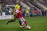 Rotherham United midfielder Jerome Thomas (7)  clears the ball ahead of Middlesbrough midfielder Emilio Nsue (24)  during the Sky Bet Championship match between Rotherham United and Middlesbrough at the New York Stadium, Rotherham, England on 8 March 2016. Photo by Simon Davies.