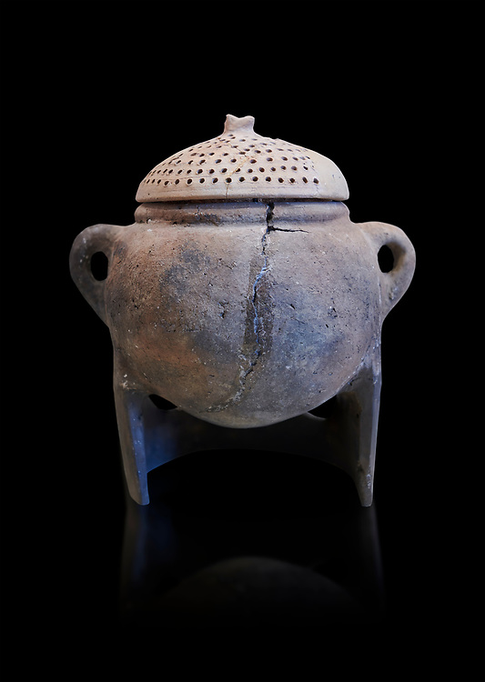 Hittite terra cotta cooking pot with perforated lid on a charcoal burner pot stand. Hittite Empire, Alaca Hoyuk, 1450 - 1200 BC. Çorum Archaeological Museum, Corum, Turkey. Against a black bacground. .<br />  <br /> If you prefer to buy from our ALAMY STOCK LIBRARY page at https://www.alamy.com/portfolio/paul-williams-funkystock/hittite-art-antiquities.html  - Alaca Hoyuk into the LOWER SEARCH WITHIN GALLERY box. Refine search by adding background colour, place,etc<br /> <br /> Visit our HITTITE PHOTO COLLECTIONS for more photos to download or buy as wall art prints https://funkystock.photoshelter.com/gallery-collection/The-Hittites-Art-Artefacts-Antiquities-Historic-Sites-Pictures-Images-of/C0000NUBSMhSc3Oo