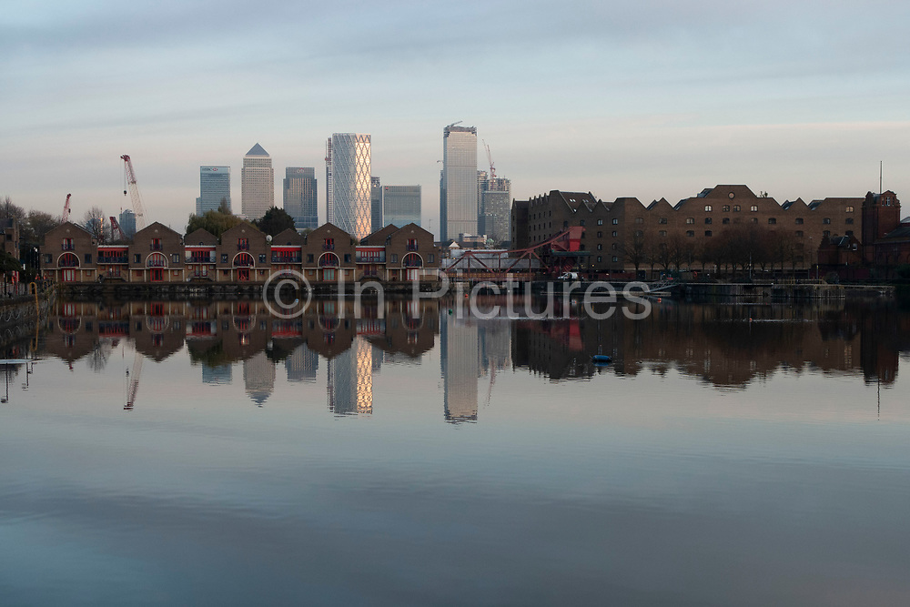 View of the Docklands area, Canary Wharf and financial district across Shadwell Basin and via the Brunel bridge in Wapping on 17th November 2019 in London, England, United Kingdom. Canary Wharf is a financial area which is still growing as construction of new skyscrapers continues. Canary Wharf is London's second home of the British financial sector.