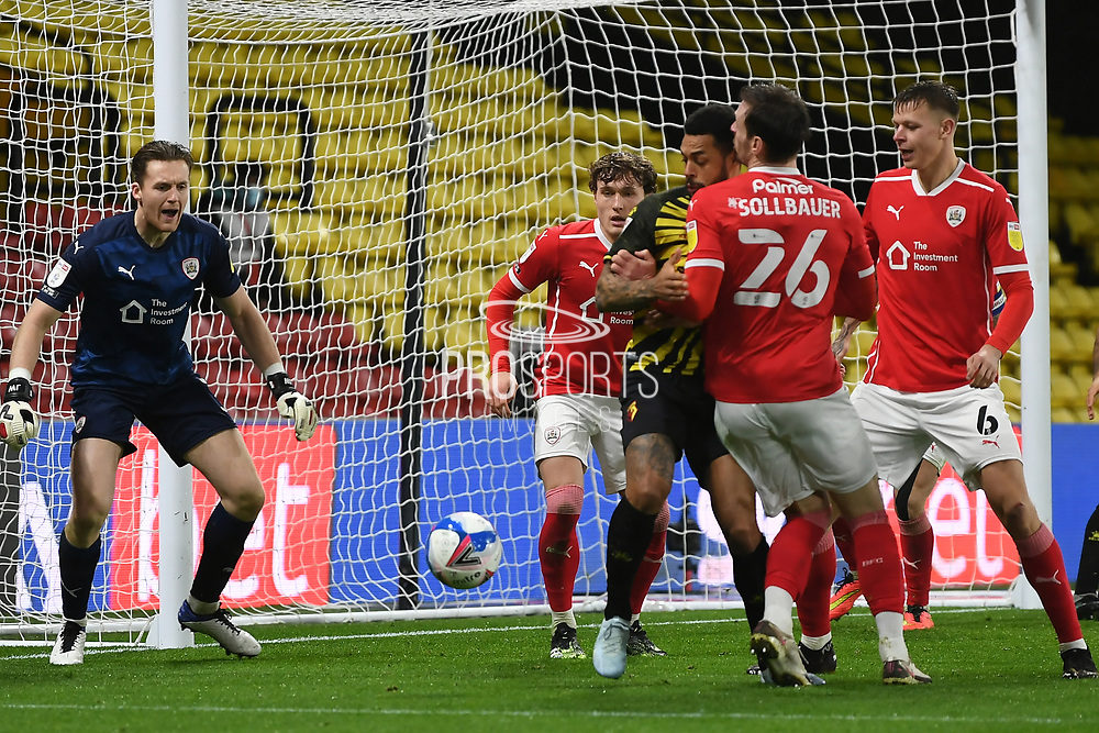 Barnsley midfielder Callum Styles (4) Watford forward Andre Gray (18) and Barnsley defender Michael Sollbauer (26) battles for possession during the EFL Sky Bet Championship match between Watford and Barnsley at Vicarage Road, Watford, England on 19 January 2021.