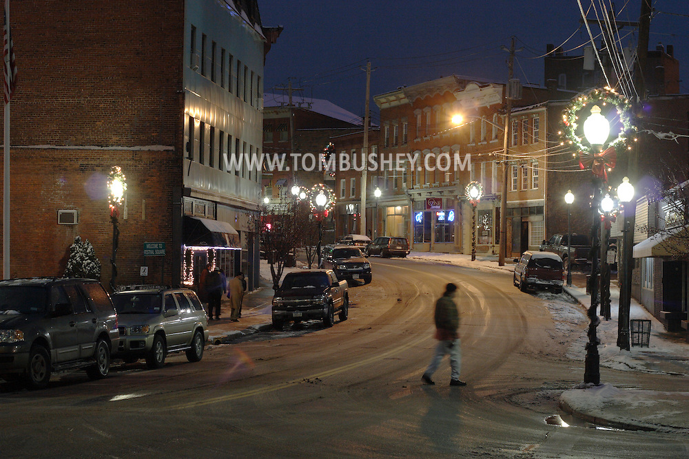 Middletown, NY - A man walks across West Main Street at night after a winter storm on Dec. 2, 2007.
