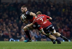 Dragons' Harrison Keddie evades the tackle of Scarlets' James Davies<br /> <br /> Photographer Simon King/Replay Images<br /> <br /> Guinness PRO14 Round 21 - Dragons v Scarlets - Saturday 28th April 2018 - Principality Stadium - Cardiff<br /> <br /> World Copyright © Replay Images . All rights reserved. info@replayimages.co.uk - http://replayimages.co.uk