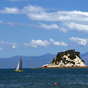A catamaran on the water near Kaiteriteri is a beautiful seaside resort town in the Nelson region, set close to the Abel Tasman National Park, New Zealand, 3rd February 2011. Photo Tim Clayton.