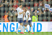GOAL 4-0. Raheem Sterling of England celebrates with teammate Harry Maguire of England after scoring a goal during the UEFA European 2020 Qualifier match between England and Czech Republic at Wembley Stadium, London, England on 22 March 2019.