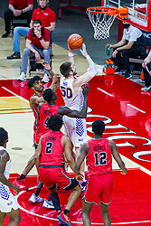 NORMAL, IL - February 27: Austin Phyfe gets inside 4 Redbird defenders during a college basketball game between the ISU Redbirds and the Northern Iowa Panthers on February 27 2021 at Redbird Arena in Normal, IL. (Photo by Alan Look)