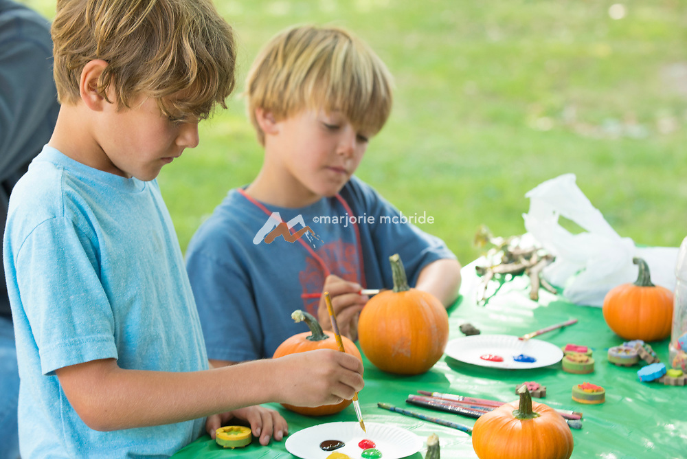 Kids painting pumpkins at the family art table Ritter Island, Thousand Springs Art Festival, Hagerman, Idaho. MR